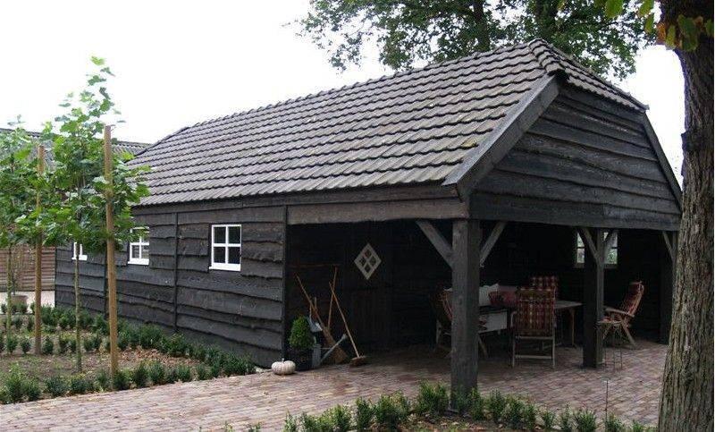 Tuinhuis met zwarte dakpannen : Schipper Groep